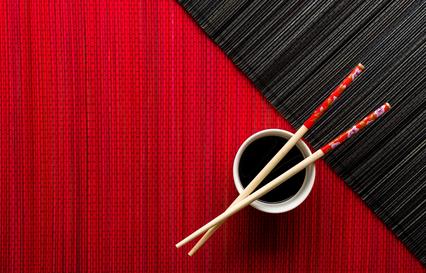 chopsticks and a bowl of soup