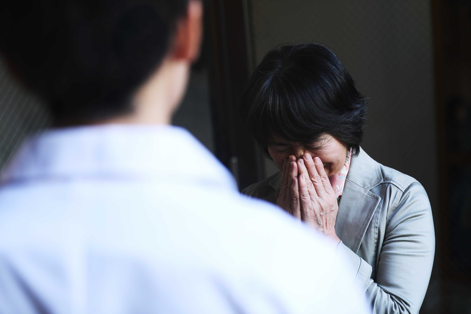 woman crying while speaking with doctor