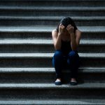 Young woman frustrated on the stairs