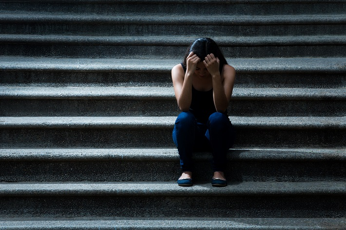 Frustrated young woman on the stairs